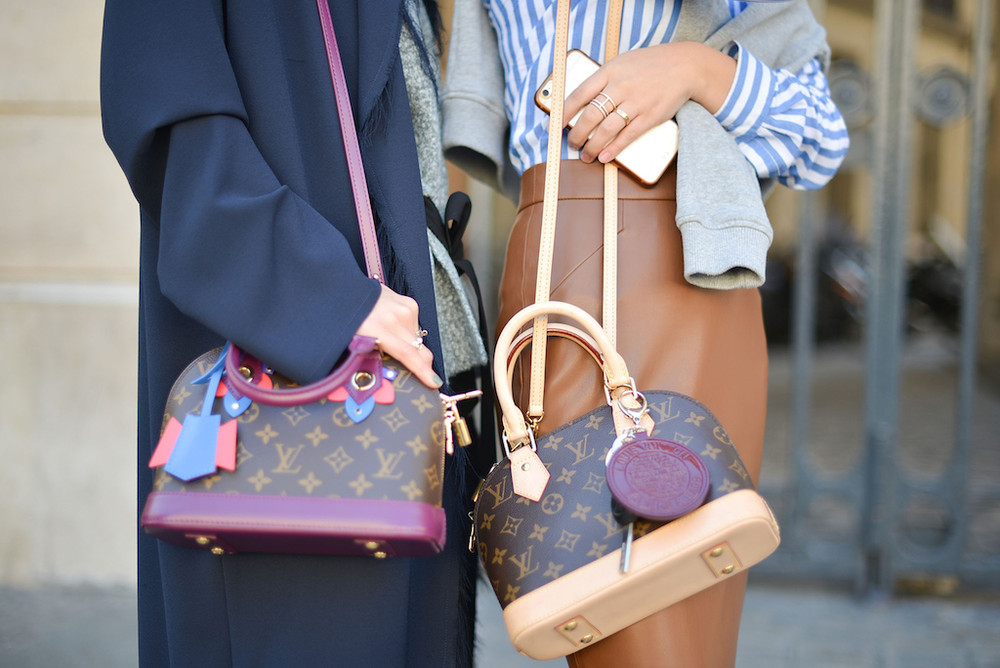 image of two women with LV Alma bags