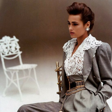 Image of model Yasmin le Bon in the 1980s rocking a grey suit.