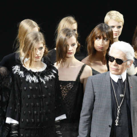 Karl Lagerfield and models walks the runway during the Chanel Autumn/Winter show.